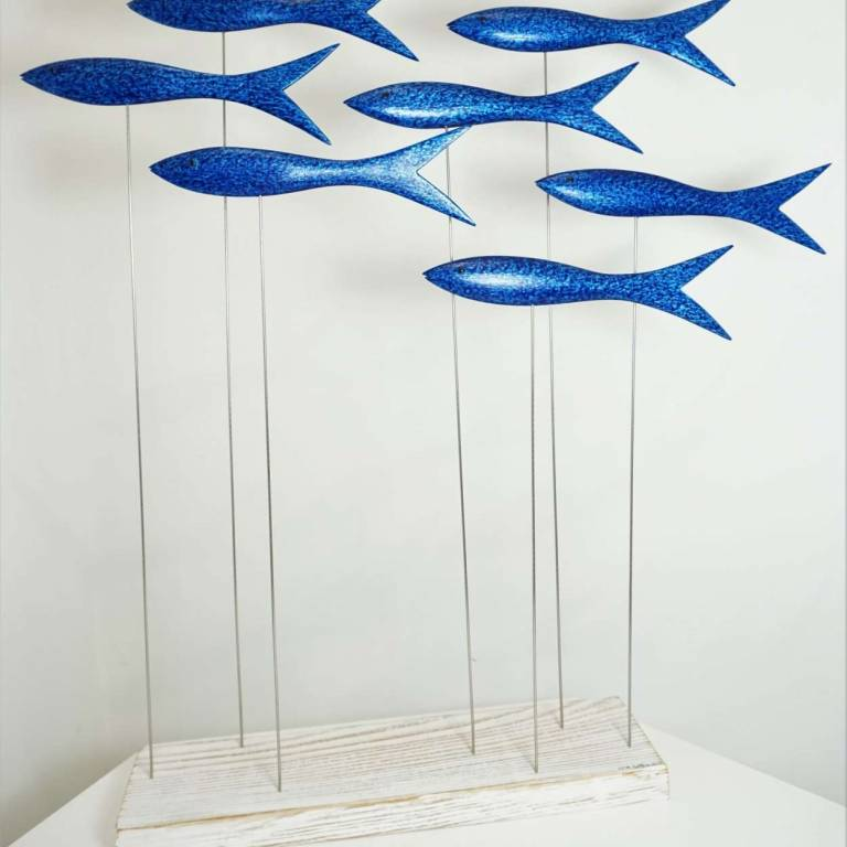 Shoal Of Seven Wee Blue Fish